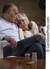Comforting his wife who is having her miserable days
