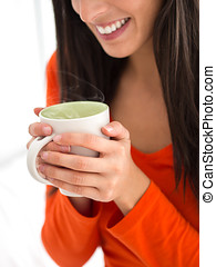 Comforting hot coffee - Woman holding hot cup of steaming...