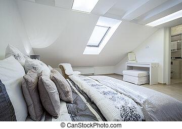 Comfy enormous bed in bright bedroom