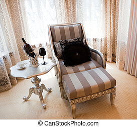 Reclining chair and table by the window