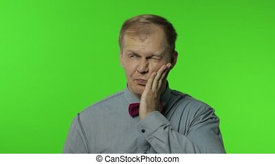 Surprised funny comical man making silly face with inflates the cheeks and looking with shocked dumb idiotic expression, grimace, fooling around. Portrait of guy posing on chroma key background