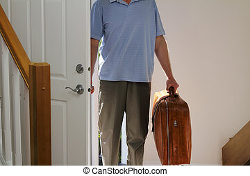 Coming Home - Man arriving from business travel inside the...