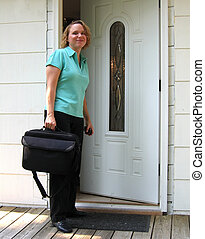 Coming Or Going - Young woman leaving or coming home for the...
