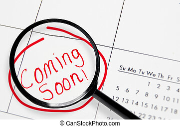 """Coming soon - Closeup of a calendar with """"Coming Soon"""" text ..."""