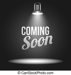 Coming soon message illuminated with light projector blank...