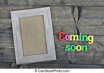 Coming Soon on wooden table