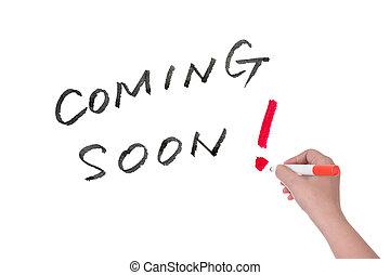 Coming soon words written on whiteboard