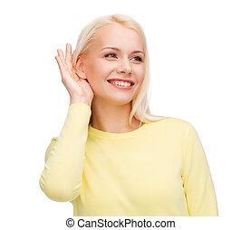 commérage, femme souriante, jeune, écoute