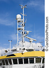 Command bridge, antennas, radar and other communication and navigation equipment on the command bridge of a ship.