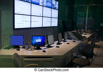 an command center with big screens and workstation