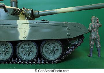 commander in overalls and helmet standing at battle tank -...