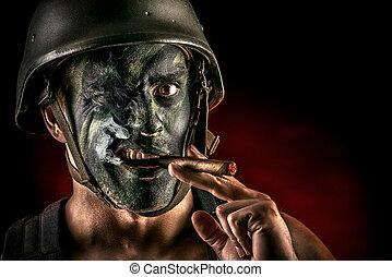 commando - Close-up portrait of a brave soldier in war paint...