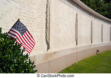 commemorate - An American flag in front of Walls of the...