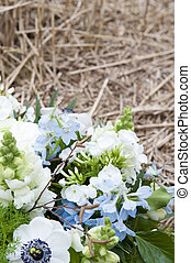 Commemoration - Blue, white and green bouquet on a natural...