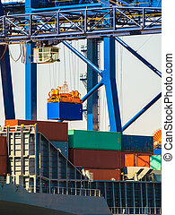 Containers transported by crane. - Commerce cargo shipping...