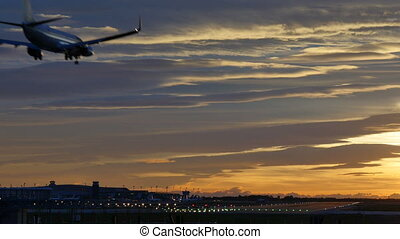 Commercial Aircraft Landing at Barcelona Airport at Sunset