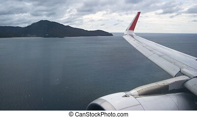 Commercial Airliner on Final Approach and Landing at Phuket Airport