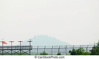 Commercial Airliner Taking Off on a Foggy Day. Video - Twin...