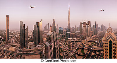 Commercial airplane flying above modern city.