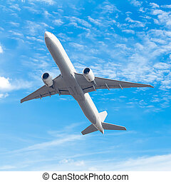 commercial airplane flying against blue sky background