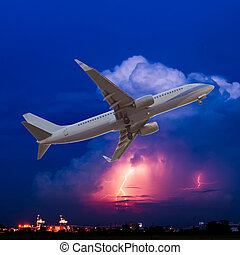 Commercial airplane flying with clouds and thunderstorm...