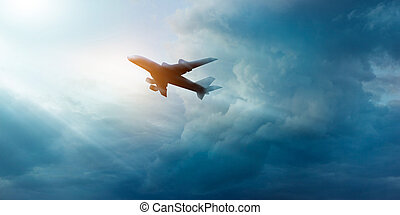 Commercial airplane in the dark sky and cloud at sunrise