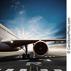 Commercial airplane on runway in day light.
