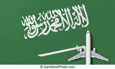Commercial airplane on the flag of Saudi arabia. Travel...