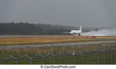 Commercial airplane on the runway in rainy day