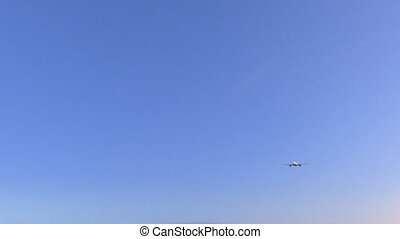 Commercial airplane passing holiday road sign. Conceptual...