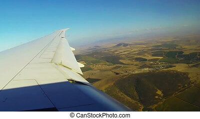 Wing of commercial airplane flight flapping in the wind