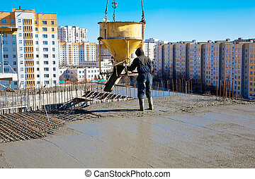 Commercial concretingin - Construction worker pouring ...