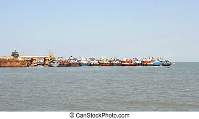 commercial fishing fleet based in the port at sunny day