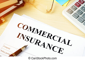 Commercial insurance policy on an office desk.