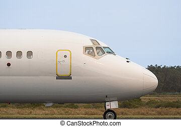 Commercial jetliner - Close up of the cockpit and exit door ...