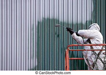 Commercial Painter - A commercial painter on an industrial ...