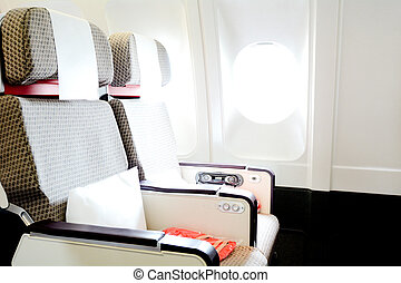 Commercial passengers airplane interior of two chairs and window. concept photo copy space