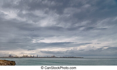 Commercial port with cranes and sea time lapse - Wide angle...