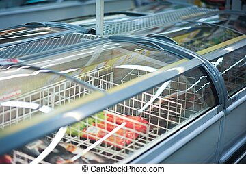 Commercial Refrigerator with Ice-Creams Inside. Cooling...