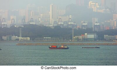 Commercial Shipping in a Channel off a Major Port City -...