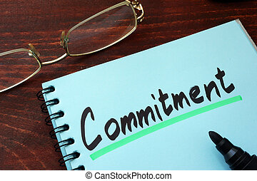 Commitment written on a notepad with marker.
