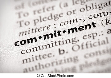 "Commitment - Selective focus on the word \""commitment\\\""...."