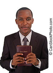 Committed - This is an image of a man holding a Bible to...