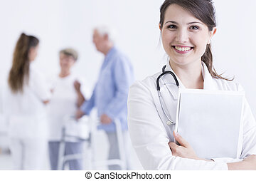 Committed to her job - Shot of a happy young doctor and a...