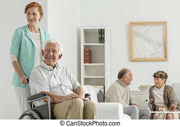 Common room at nursing home with seniors