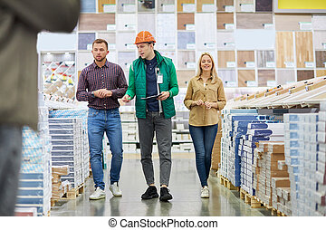communicable warehouse worker show assortment to customers