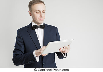 Communication and Internet Concept. Portrait of Young Handsome Caucasian Man Using Digital Pad for Communication.