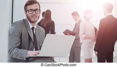 communication concept:businessman with a stylish laptop on the k