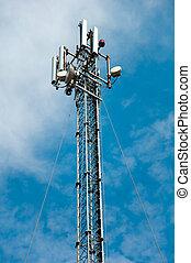 Communication derrick against the blue sky