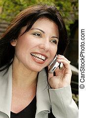 Communication freedom - Happy brunette on the phone